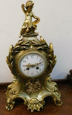 french brass cased striking mantel clock with cherub surmount