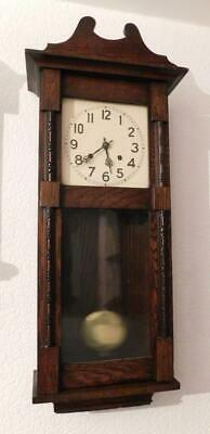 oak cased striking wall clock