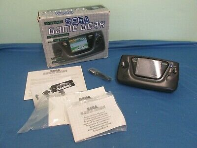 Boxed Sega game gear with inserts and manuals - no games