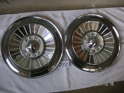 1957 Ford, Thunderbird hub caps 14 in. pair very good used my#2350sp