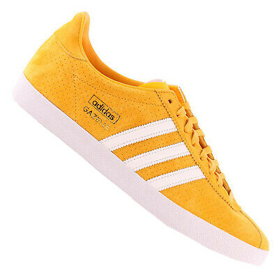 sports shoes 4c206 7f394 Adidas Originals Gazelle Mens Sneakers Leather Trainers Yellow Gold White