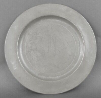 18th Century English Pewter Plate. With Touchmarks. 9.75 inches . 25cm diameter.
