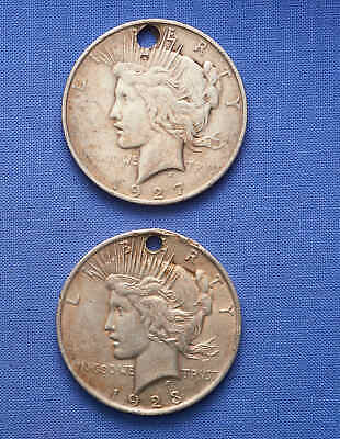 2 Peace Silver Dollars. Holed. 1923, 1927. Sold Together. No Reserve.