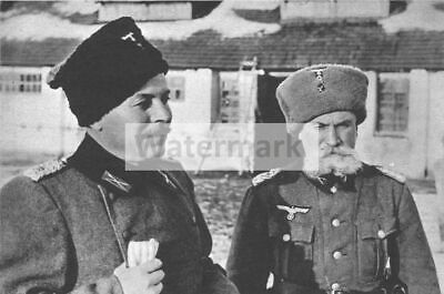 WWII photo Cossack collaborator cuts saber captive Soviet soldiers in front  121