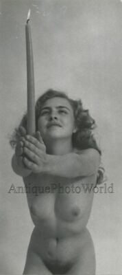 Nude woman posing with long lit candle vintage art photo