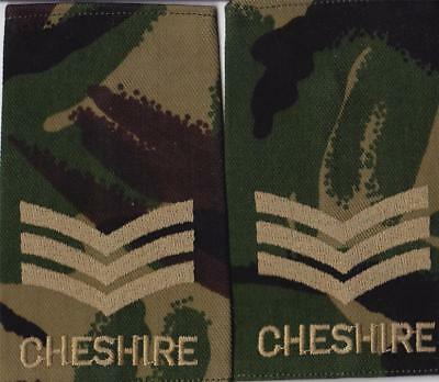 Pair of British CHESHIRE REGIMENT SERGEANT  rank slides WOODLAND CAMO UNISSUED