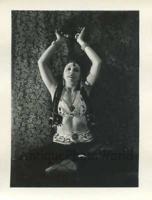Sexy woman belly dancer in exotic costume antique pinup photo
