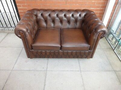 A Tanny Brown Leather Chesterfield Two Seater Settee ***DELIVERY AVAILABLE**
