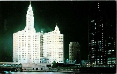 Vintage Postcard Wrigley Building And Tribune Tower At Nite Chicago Illinois