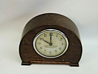Small Wooden Wind-Up Mantle Clock.  (Hospiscare)
