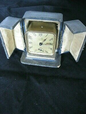 Rear Antique BREVETE French made travel brass alarm clock in case working.
