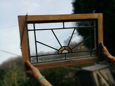 Old piece of stained glass 1930s sunburst in wood frame with chain to hang