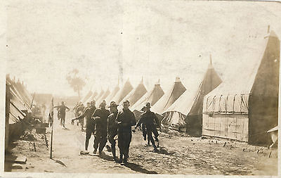 WWI RPPC Soldiers in Tent Camp, Running, Sepia Real Photo Postcard