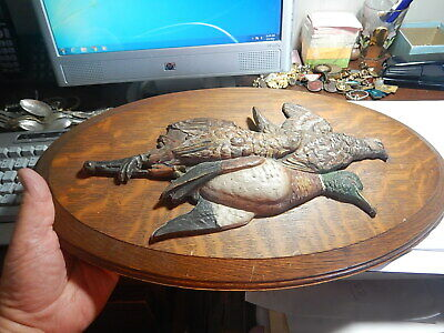 Old oval oak plaque 19 inches two hanging metal dead ducks very old estate