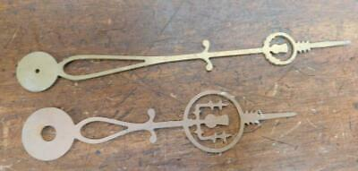 a pair of brass longcase hands