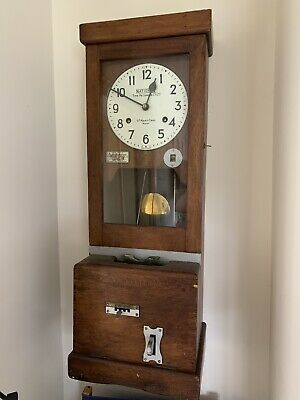 Clocking in fusee wall clock. St Mary Cray, Kent. National Time Recorder.
