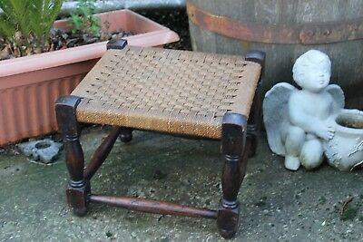 An early 20th century  small stool in oak.