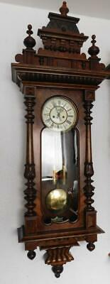 walnut cased double weight vienna wall clock  with keyhole front