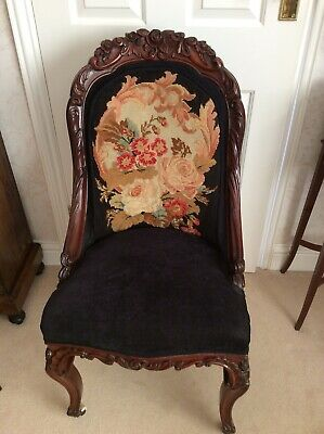 Antique Ornately Carved Chair Upholstered In Black With Tapestry Decoration