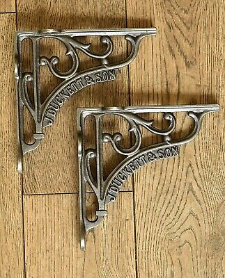 A pair of cast iron antique style J Duckett & Son brackets shelf brackets AL80