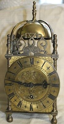 A working vintage lantern or chamber clock in brass