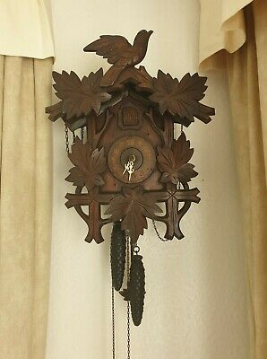 antique cookoo clock wood in good condition but needs TLC