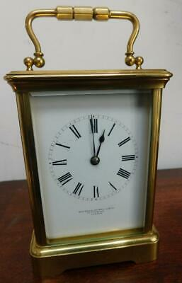 striking brass cased carriage clock retailed by howell james london