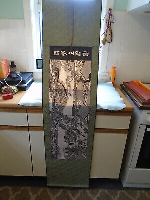 A Boxed Chinese Paper Cutting Scroll On Silk Village Market Scene