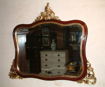 Large 19th Century French Carved gilt wood and Mahogany over mantle mirror.