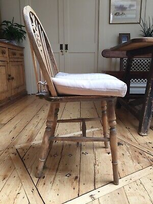 Four Antique/Vintage Wheel Back Chairs in Pine, with cushions