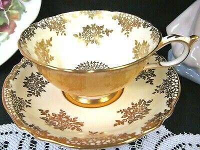 Paragon tea cup and saucer YELLOW gold gilt rose chintz teacup wide mouth