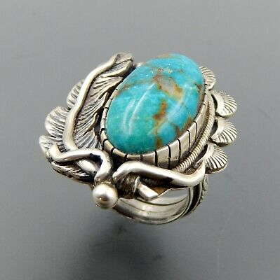 Handcrafted sterling silver oval turquoise feather ornate solid ring size 8.75