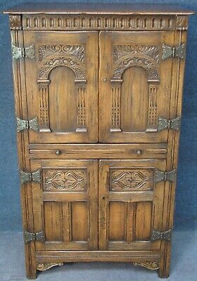 Jacobean Style Carved Oak Drinks Cabinet With Serving Slide