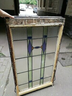 Old piece of stained glass in original wood frame