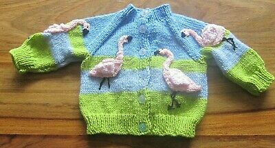 BEAUTIFUL PINK FLAMINGOES  HAND KNITTED BABY CARDIGAN. AGE 3-6m.