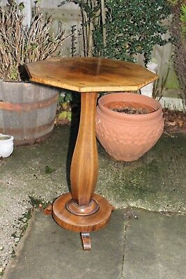 A lovely Art Nouveau wine table in good condition.
