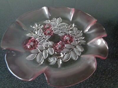 Large pink frosted glass plate with floral and leaf design in base very pretty