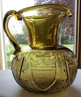 Antique SHield Flag Embossed Hand Blown Amber Glass Water Pitcher Pontil Bottom