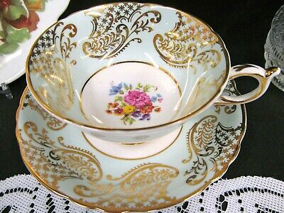 Paragon tea cup and saucer baby blue floral gold gilt teacup wide mouth shape