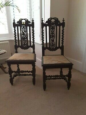 A pair of original antique Victorian Jacobean revival chairs.