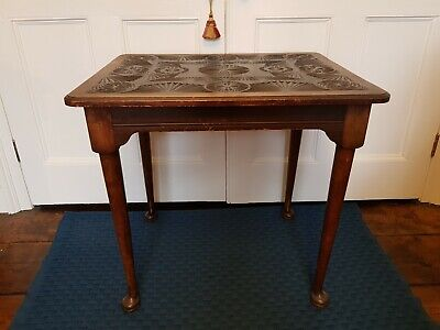 Attractive antique side table with carved top