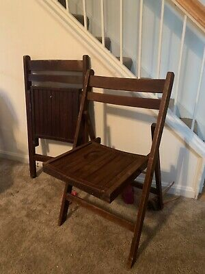 antique wood folding chairs -4 brown sturdy folding chairs in good condition.