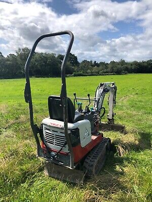 Takeuchi TB108 Mini Digger. 2014. Comes with quick hitch and 3 buckets. 1500 hrs