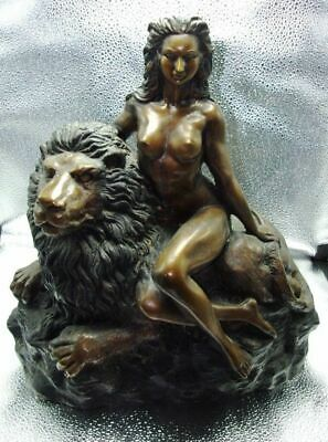 Antique bronze statue, nude women seated on a lion