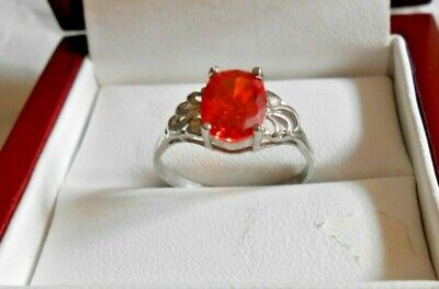 Silver colored ring with oval scarlet colored stone size 6.5