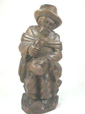 """Hand Carved Wooden Figure-Wandering Peasant Man Seated-6.5"""" Tall-Dark Wood"""