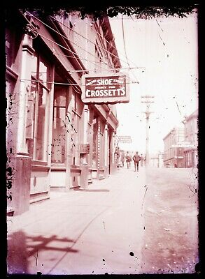 LATE 1800s EARLY 1900s GLASS NEGATIVE, STREET SCENE, STORES, UNKNOWN LOCATION