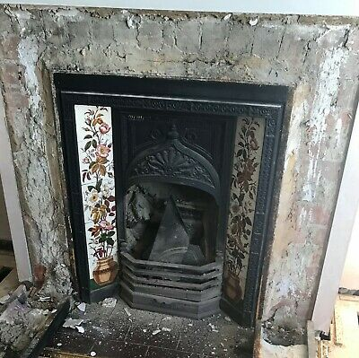 Victorian style cast iron tiled fireplace.