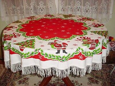 "Vtg Christmas 60"" Round Tablecloth Snowflakes Santa Bells Trees Fringe Bright!"