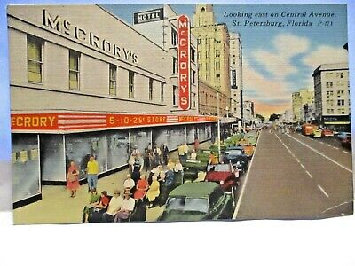 1940 POSTCARD THE SIDEWALKS OF ST PETERSBURG McCRORY'S  STORE GREEN BENCHES BIO
